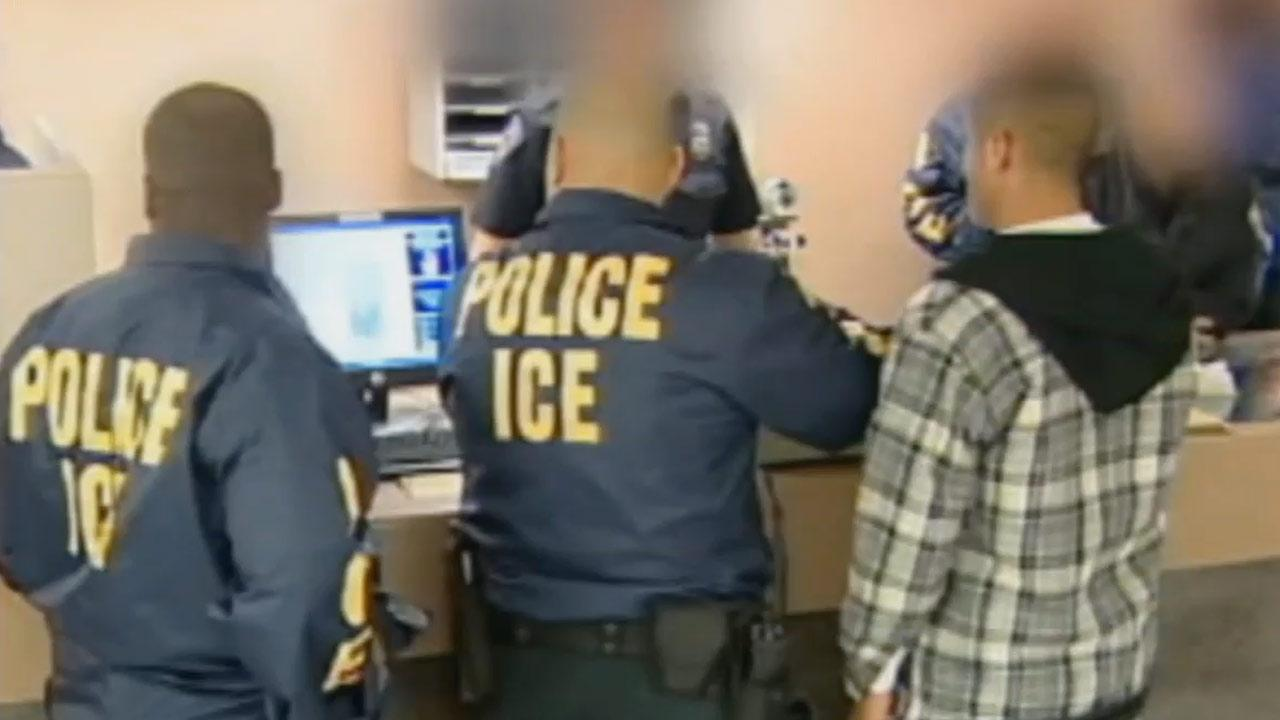 Undated file photo of Immigration and Customs Enforcement agents.