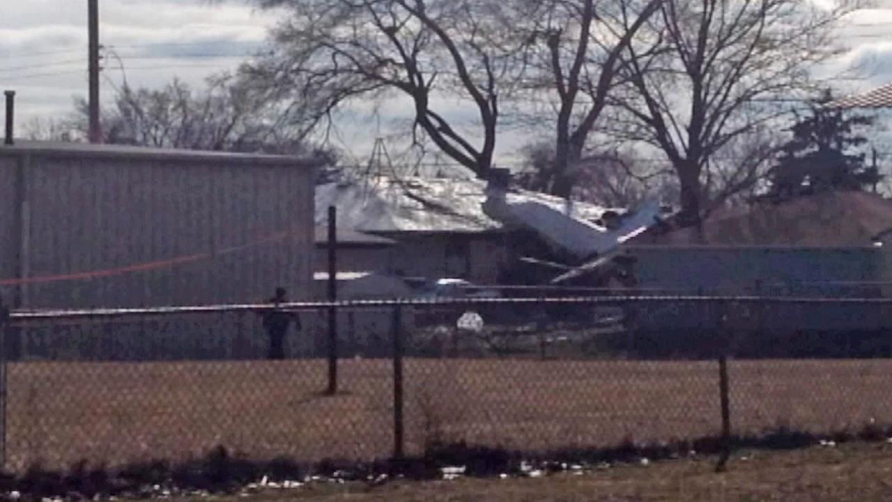 A Beechcraft Premier I twin-jet is seen after it crashed into homes in a South Bend, Ind., neioghborhood, killing two people Sunday, March 17, 2013.