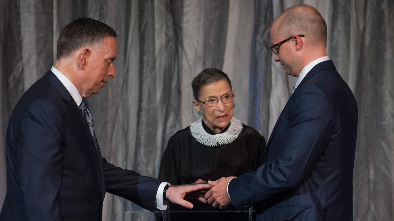 Supreme Court Justice Ruth Bader Ginsburg officiates at the wedding of Kennedy Center President Michael Kaiser (left) and government economist John Roberts (right) at the Kennedy Center for the Performing Arts on Saturday, Aug. 31, 2013.