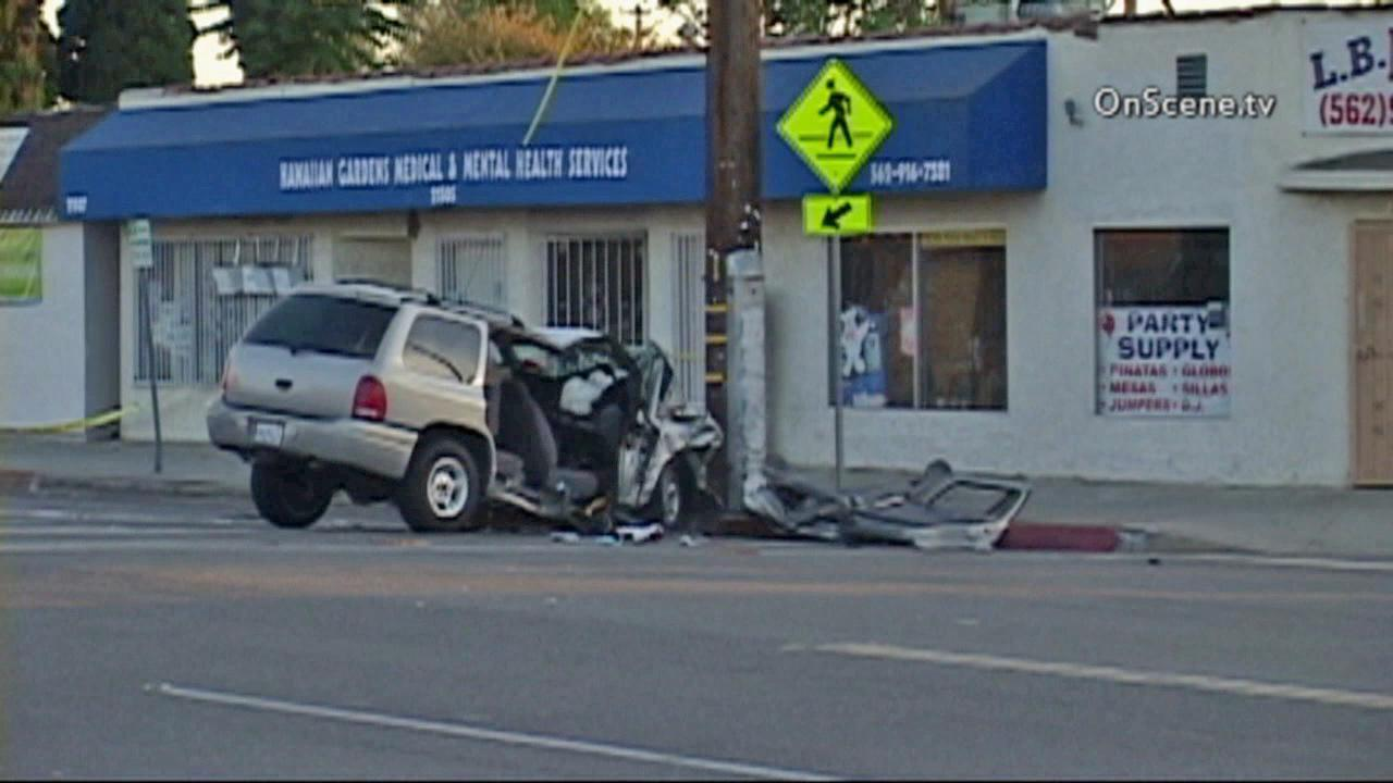 A car is seen after it was shot at and crashed into a telephone pole in Hawaiian Gardens on Saturday, Aug. 31, 2013.