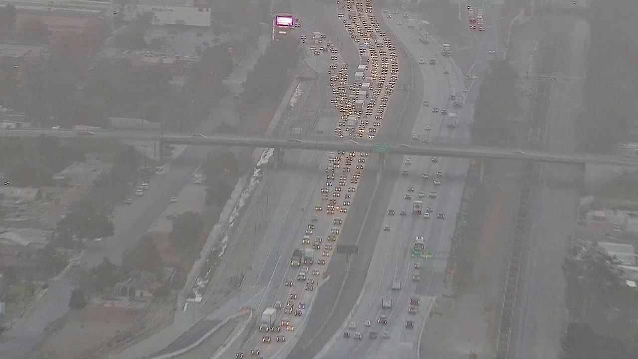 Backup from a big-rig crash on the westbound 10 Freeway in Fontana is seen Friday, Oct. 4, 2013.