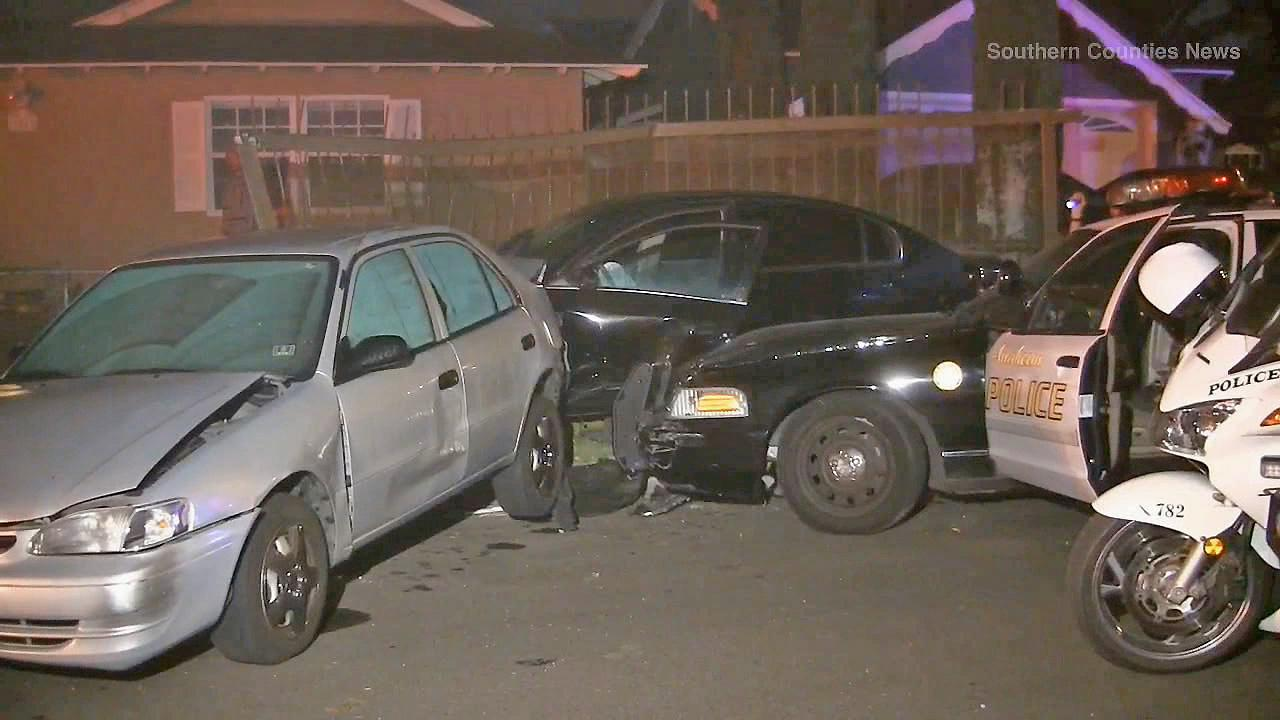 Two cars are seen at the end of a high-speed chase in Anaheim on Sunday, Oct. 27, 2013.
