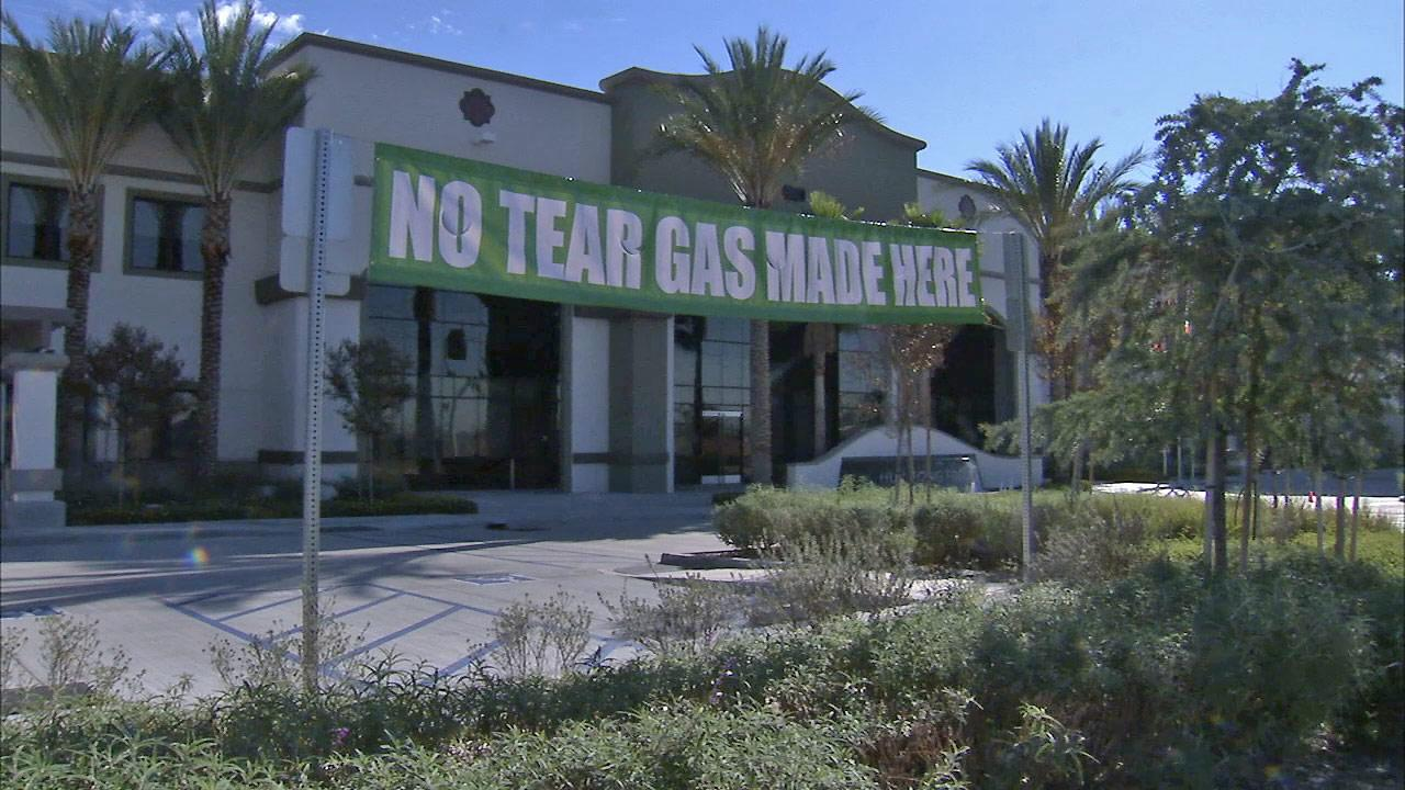 A sign that reads No Tear Gas Made Here is seen outside the Sriracha factory in Irwindale, Calif.