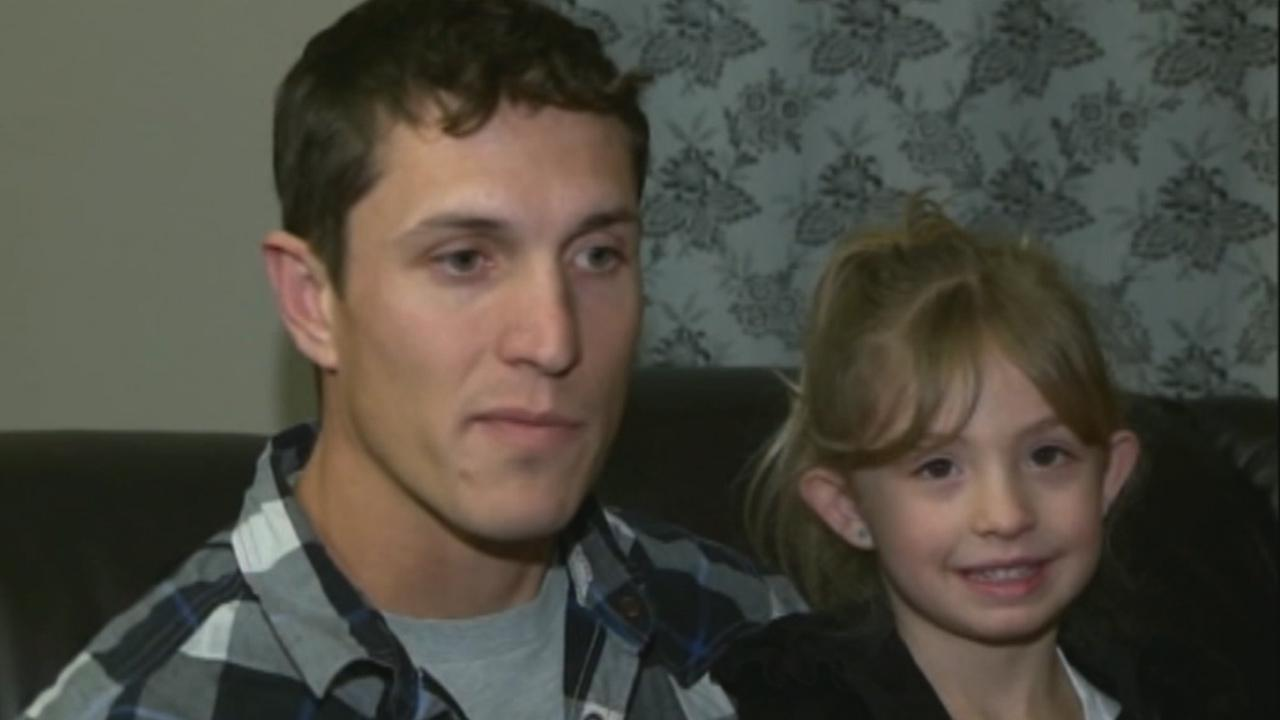 Army Corporal Chris Petrossian is seen with his 4-year-old daughter.