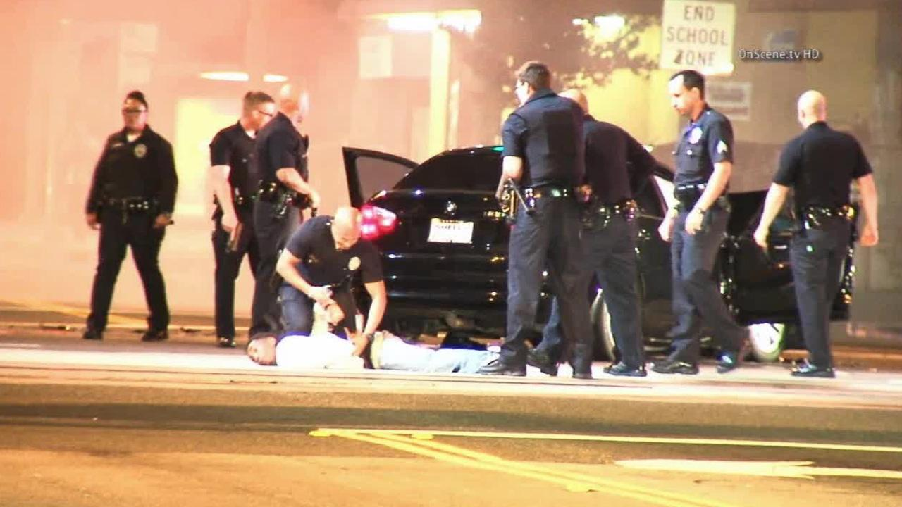 A suspect is arrested following a high-speed chase in South Los Angeles on Saturday, March 15, 2014.