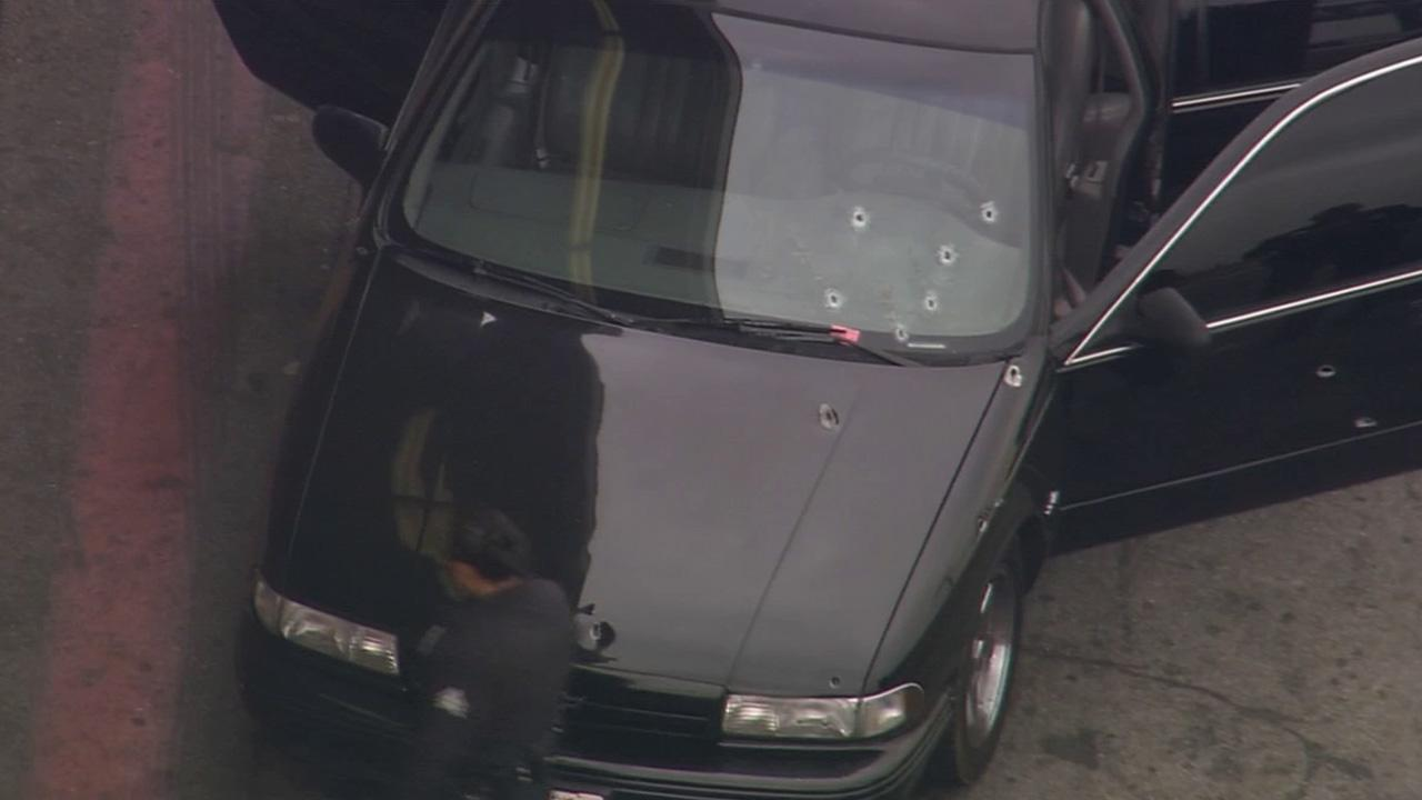 Bullet holes are seen on a car that was shot at in South Los Angeles on Tuesday, March 25, 2014.
