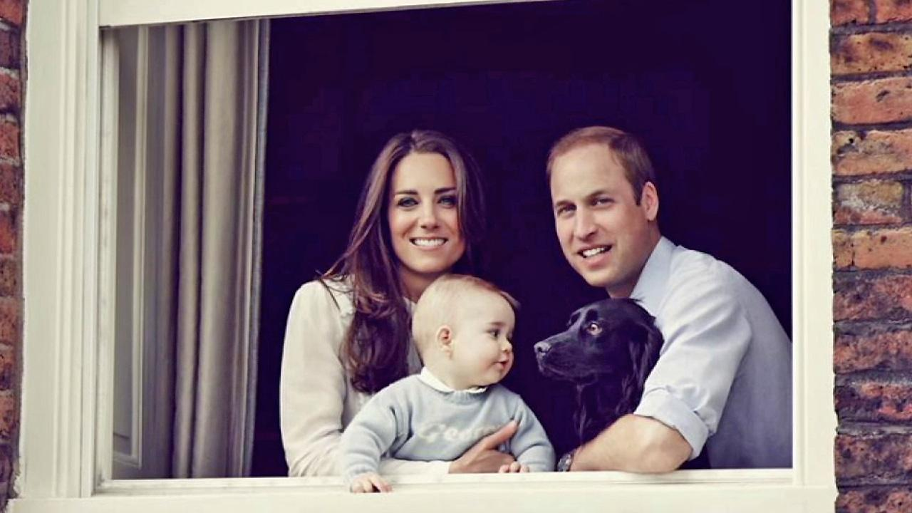 Kate, Duchess of Cambridge (left) poses with son Prince George (center) and Prince William, Duke of Cambridge (right) in this March 2014 photo.