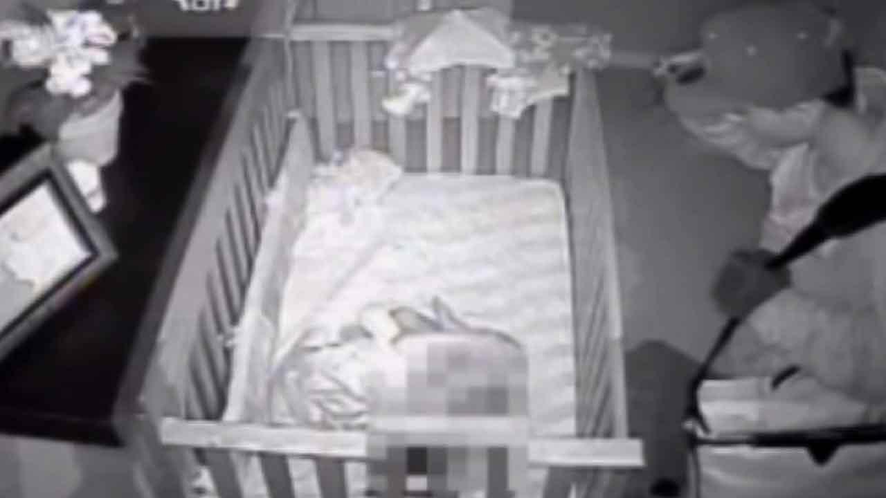 A burglar near Houston was caught on video walking into a babys room and stopping to watch the child sleep.