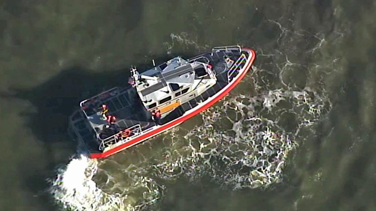 The Coast Guard searches for the pilot of a small plane that collided with another small plane over the San Francisco Bay on Sunday, April 27, 2014.