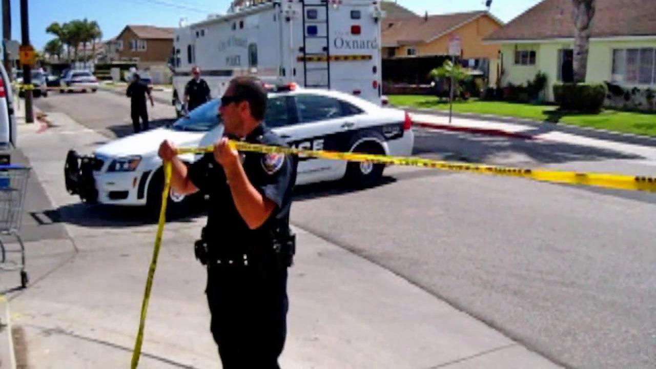 Authorities investigate a body found in Oxnard on Sunday, April 27, 2014.
