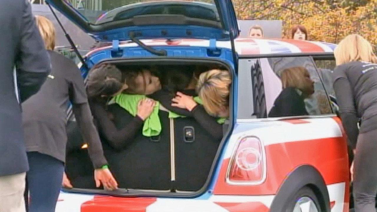 Twenty-eight women crammed into a Mini Cooper, setting a new Guinness World Record.