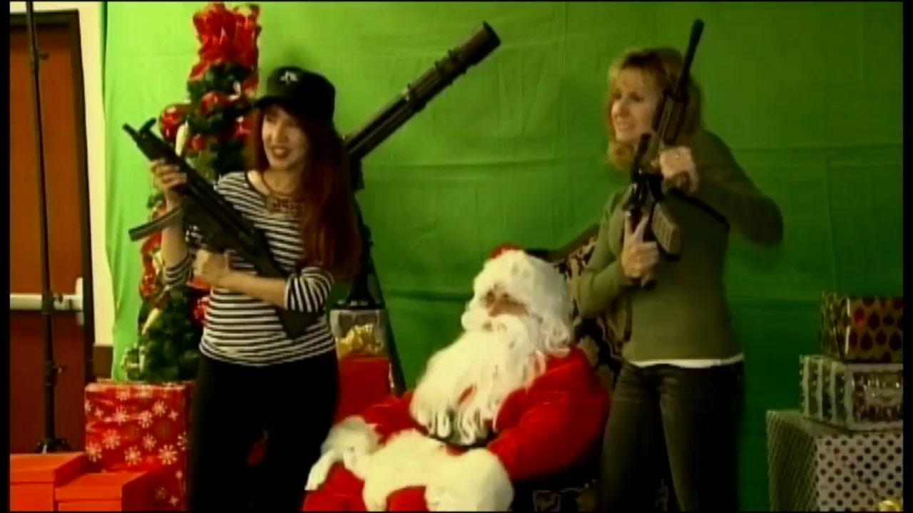 Families in Scottsdale, Arizona have the opportunity to take holiday portraits with Santa Claus and a machine gun.