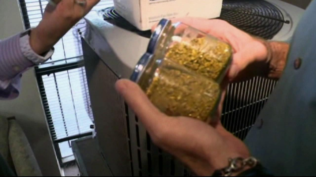 Twelve baby food jars filled to the brim with gold dust were found underneath the floors of a Sacramento home.