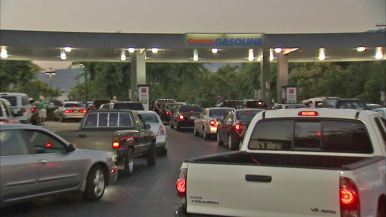 Vehicles line up to get gas at the Costco gas station in Burbank on Thursday, Oct. 4, 2012.