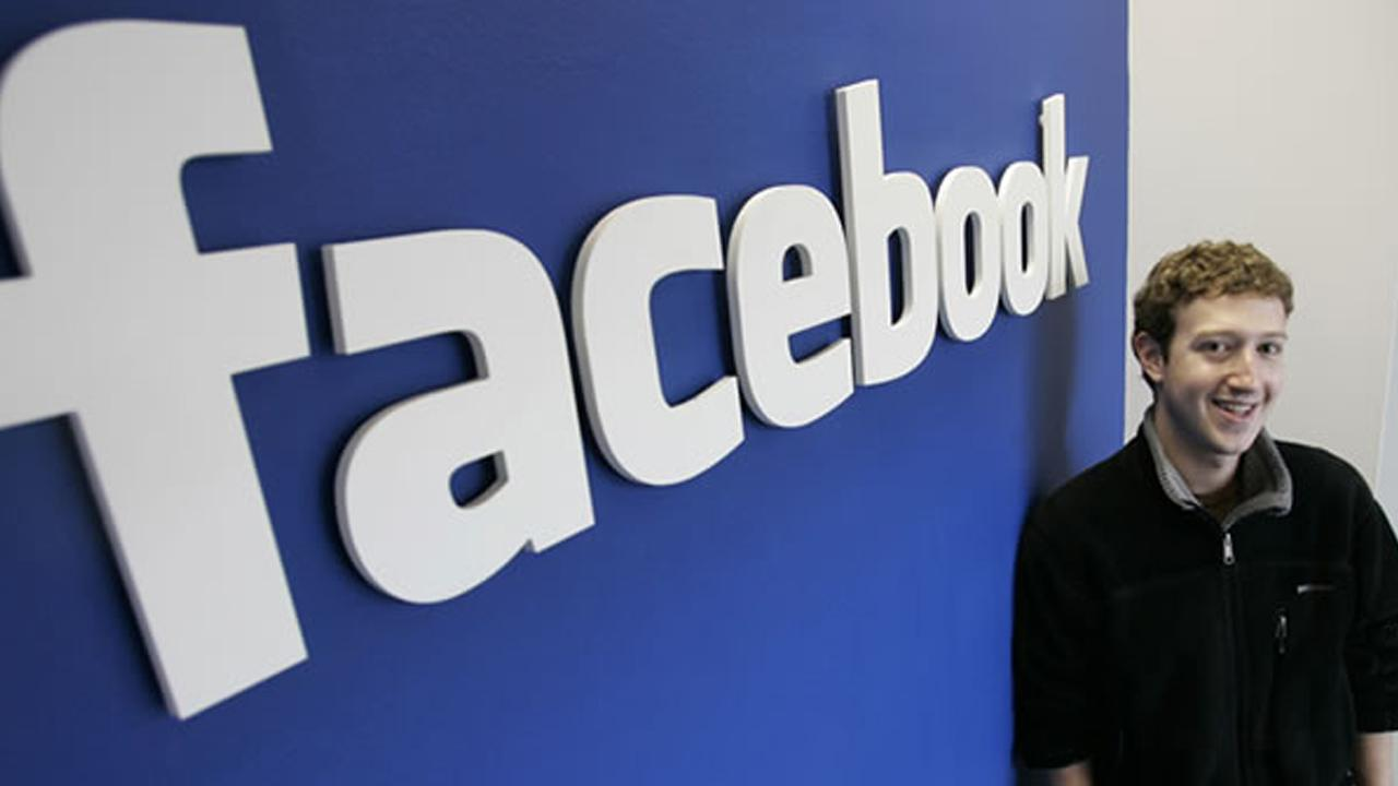 In this Feb. 5, 2007 file photo, Facebook CEO Mark Zuckerberg poses at his office in Palo Alto, Calif.