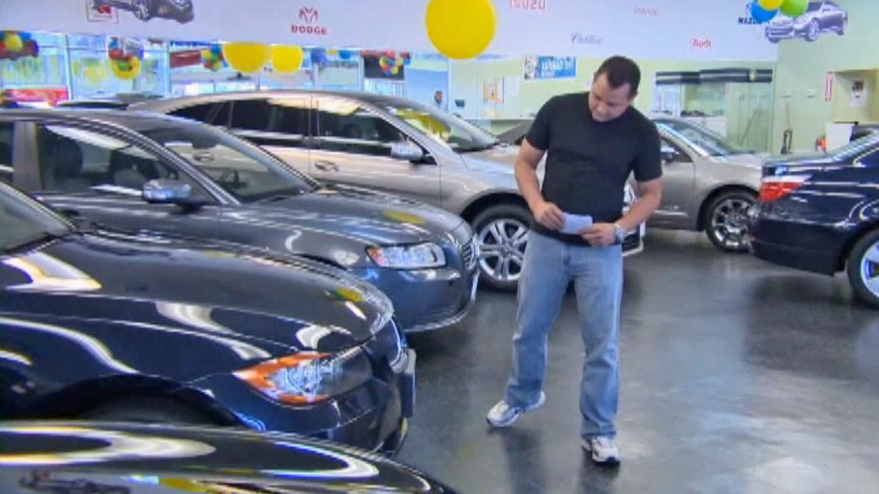 A man checks out used cars in a showroom in this undated file photo.