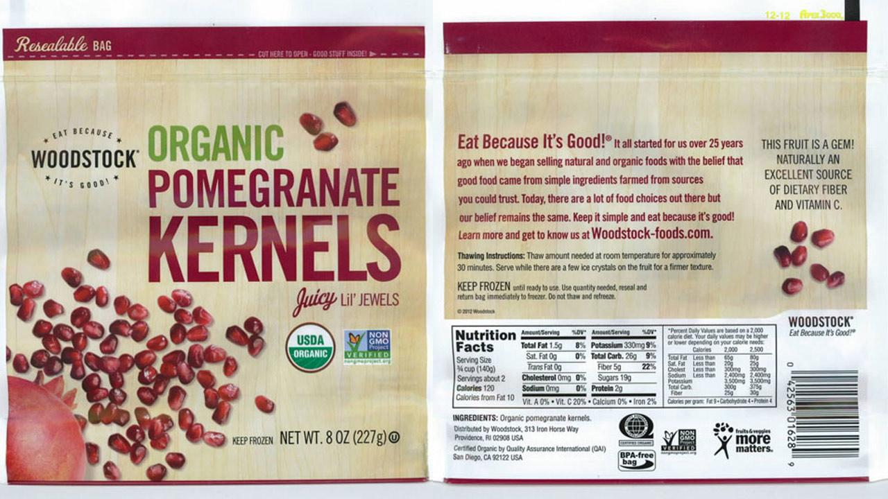 The label for Woodstock Frozen Organic Pomegranate Kernels is seen.
