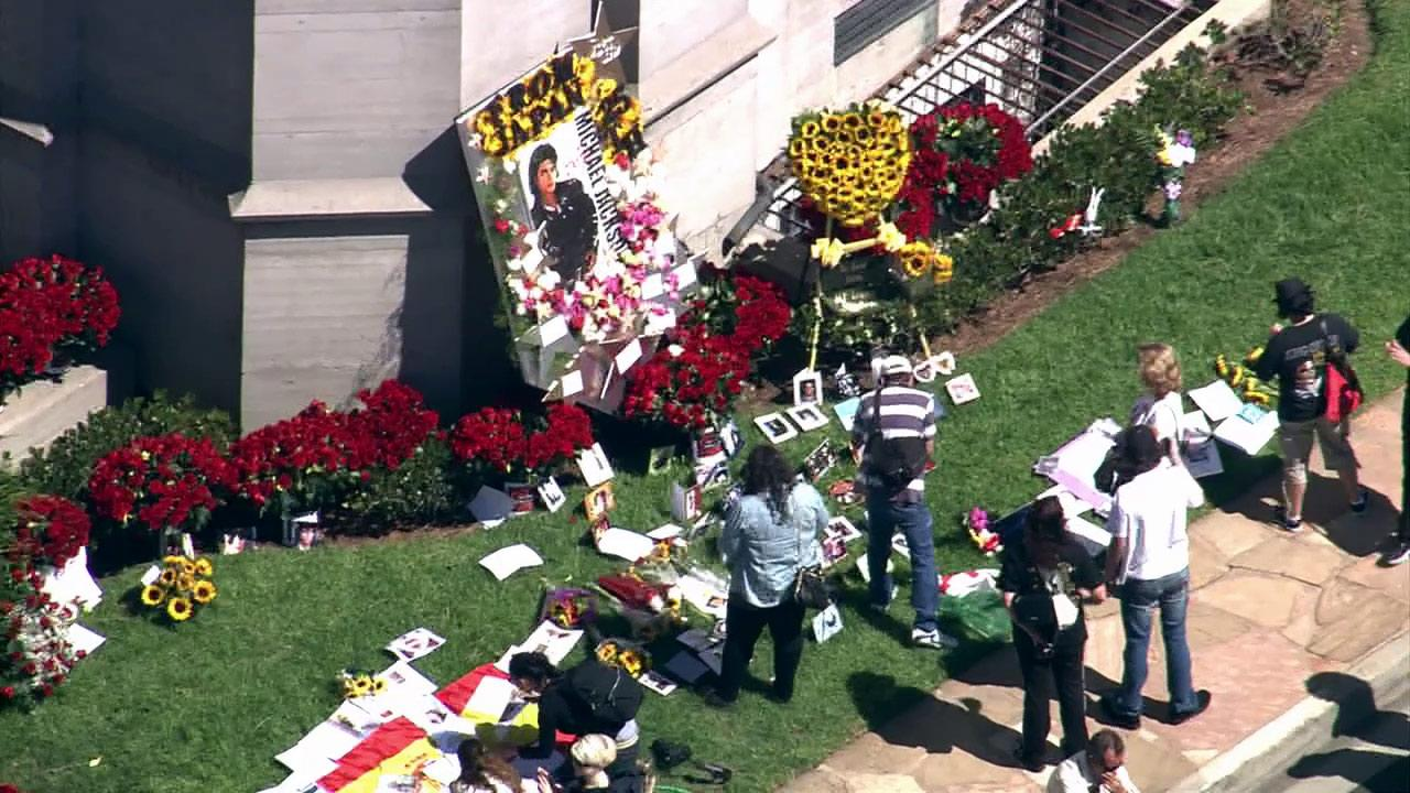 Michael Jackson fans gather for the third anniversary of the singers death outside the mausoleum where Jackson is buried in Forest Lawn Cemetery in Los Angeles on Monday, June 25, 2012.