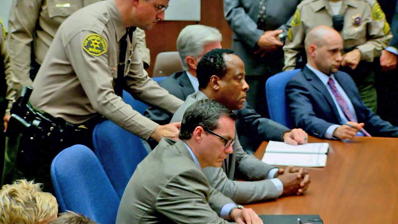 A sheriff is seen in court preparing to take Dr. Conrad Murray into custody in this undated file photo.