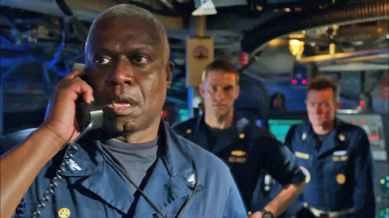 Actors from Last Resort appear in this still from the show.