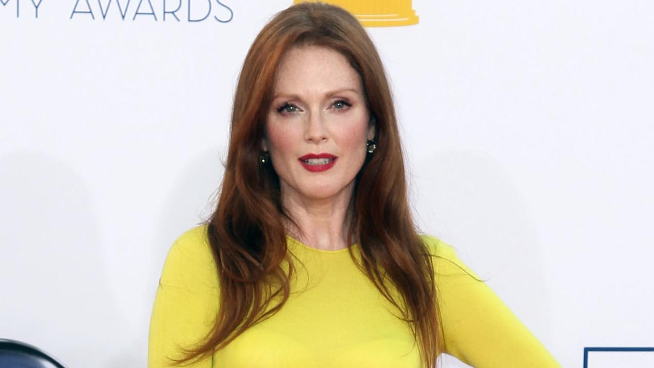 Julianne Moore arrives at the 64th Primetime Emmy Awards at the Nokia Theatre on Sunday, Sept. 23, 2012, in Los Angeles.