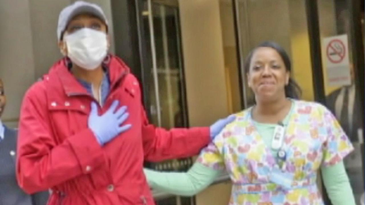 Good Morning America co-host Robin Roberts steps out of a New York hospital and takes her first breath of fresh air on Wednesday, Oct. 10, 2012.