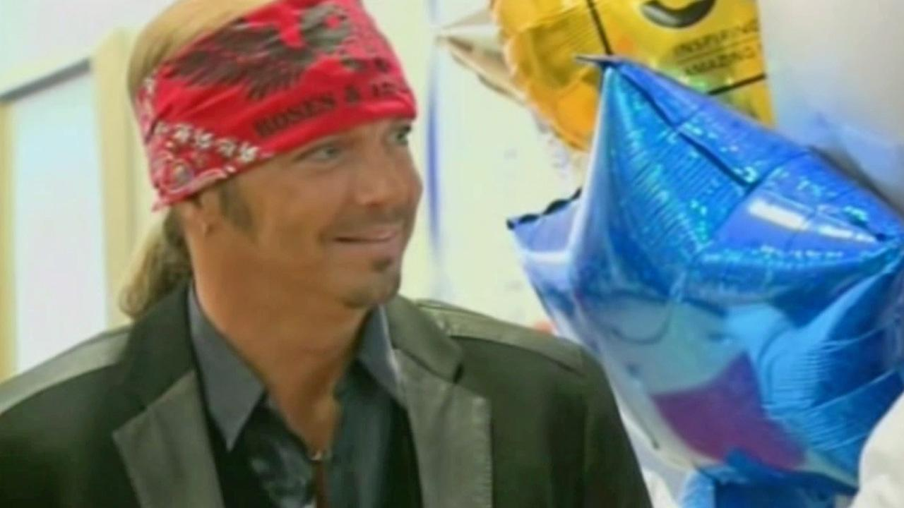 Former Poison frontman Bret Michaels is shown at an unveiling ceremony at St. Josephs Barrow Neurological Institute, where he donated the Bret Michaels Hospitality and Music Room on Tuesday, Oct. 9, 2012.