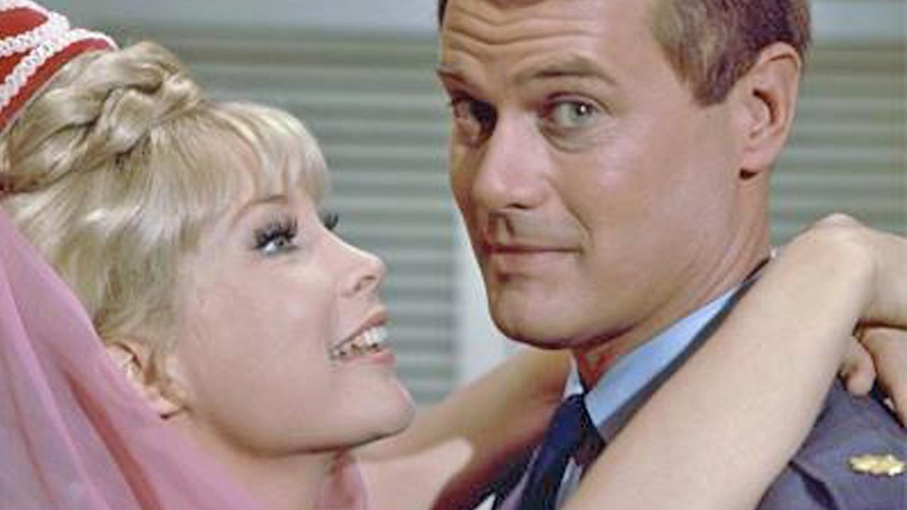 Barbara Eden and Larry Hagman are seen in a still from I Dream of Jeannie.
