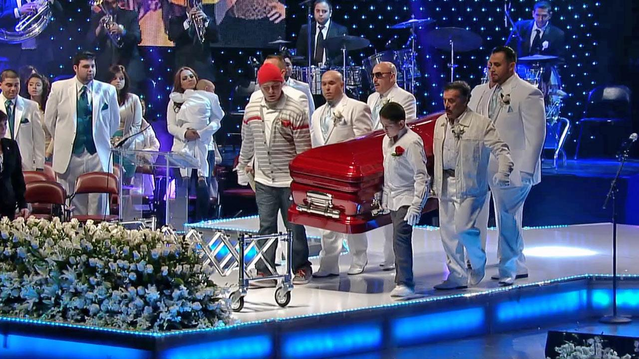 Pallbearers carry the coffin of Jenni Rivera to the stage at the singers public memorial service at the Gibson Amphitheatre on Wednesday, Dec. 19, 2012.