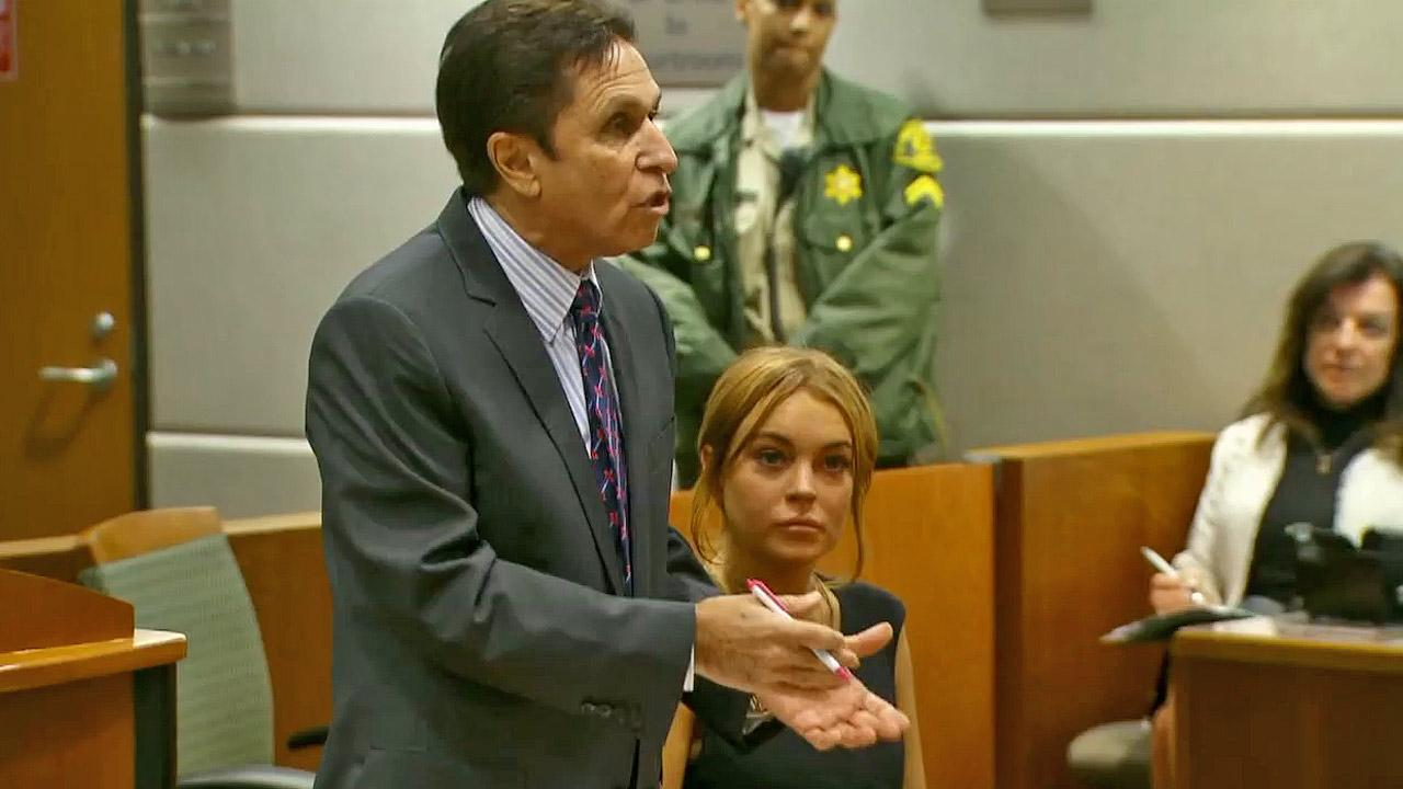 Actress Lindsay Lohan appears in court with her new attorney, Mark Heller, by her side on Wednesday, Jan. 30, 2013.
