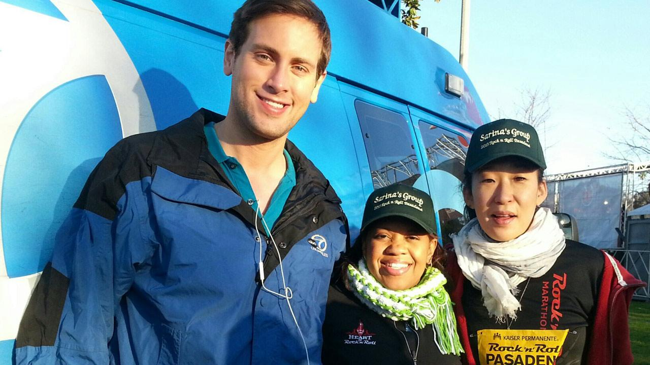 Chandra Wilson and Sandra Oh from the ABC medical drama Greys Anatomy pose with ABC7 photographer Sean Patrick Lewis at the annual Rock n Roll Half Marathon in Pasadena on Sunday, Feb. 17, 2013.