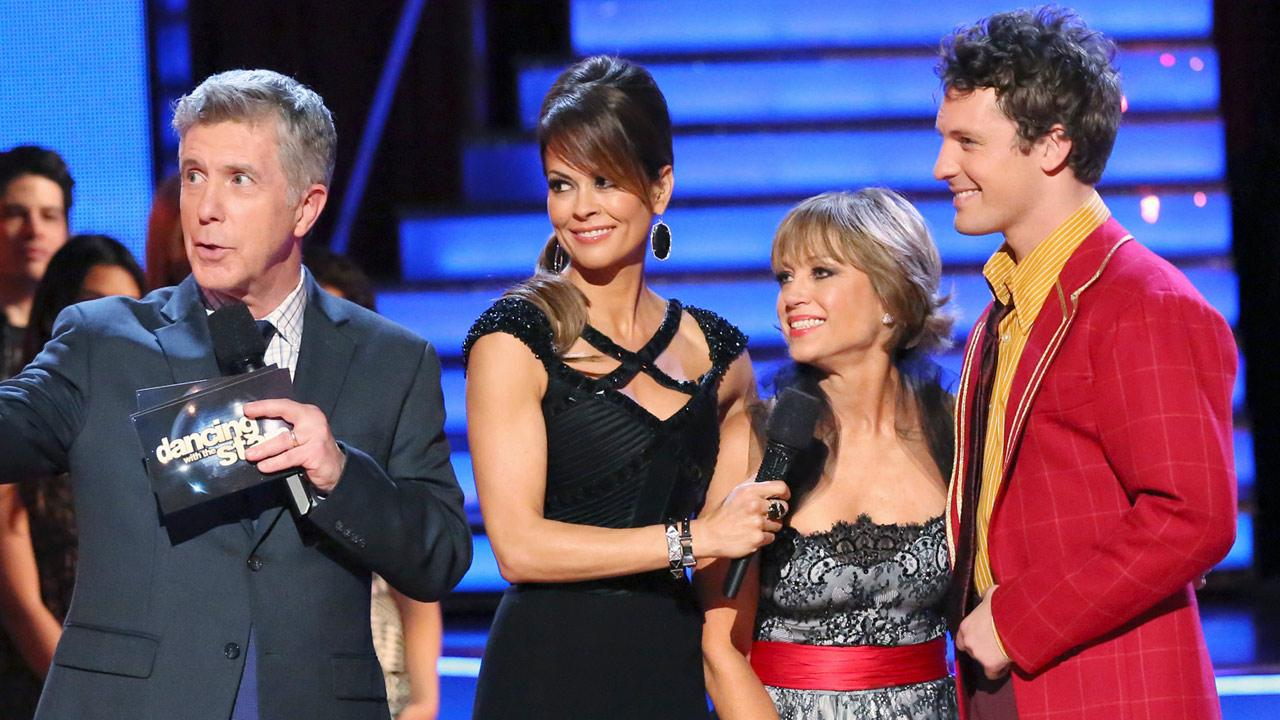 Olympic figure skater Dorothy Hamill and her partner Tristan MacManus react after withdrawing from the competition on the first results show for Dancing With The Stars season 16, which aired on March 26, 2013.