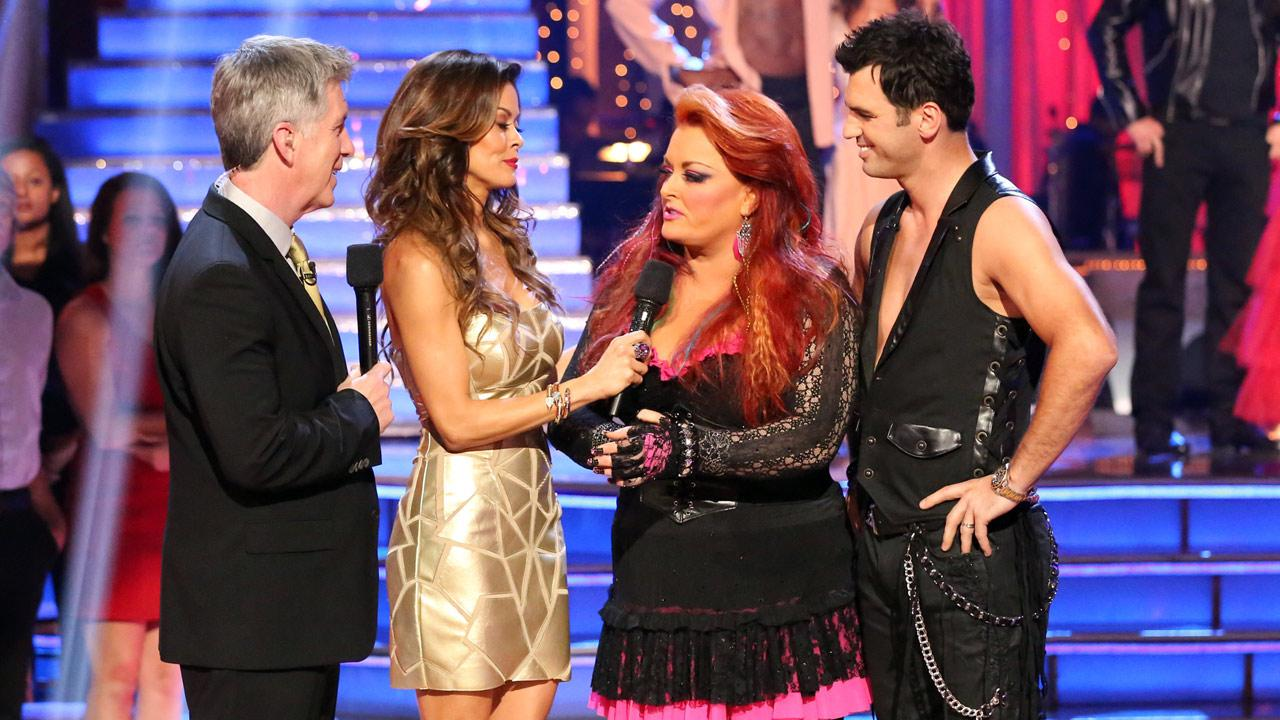 Country singer Wynonna Judd and partner Tony Dovolani talk with hosts Tom Bergeron and Brooke Burke-Charvet after being eliminated from the competition on the Dancing With The Stars: The Results Show on Tuesday, April 2, 2013.