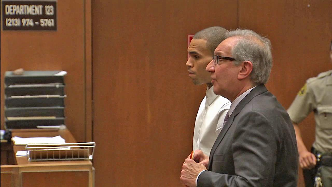 Singer Chris Brown, left, is seen in a Los Angeles courtroom with attorney Mark Geragos, right, on Friday, April 5, 2013.