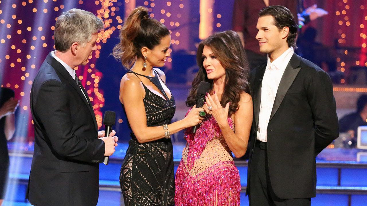 Reality star Lisa Vanderpump and her partner Gleb Savchenko talk with hosts Tom Bergeron and Brooke Burke-Charvet after being eliminated from the competition on the Dancing With The Stars: The Results Show on Tuesday, April 9, 2013.