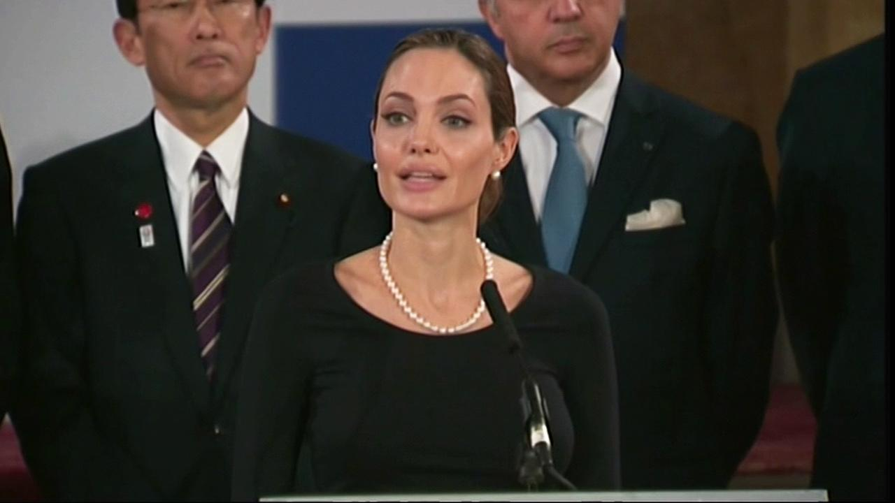 Angelina Jolie talks during a news conference at the G8 Foreign Ministers meeting in London, Thursday, April, 11, 2013.
