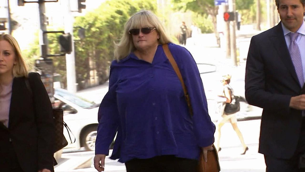 Michael Jacksons ex-wife Debbie Rowe walks up to a Los Angeles courtroom to testify in the pop icons wrongful death trial on Wednesday, Aug. 14, 2013.