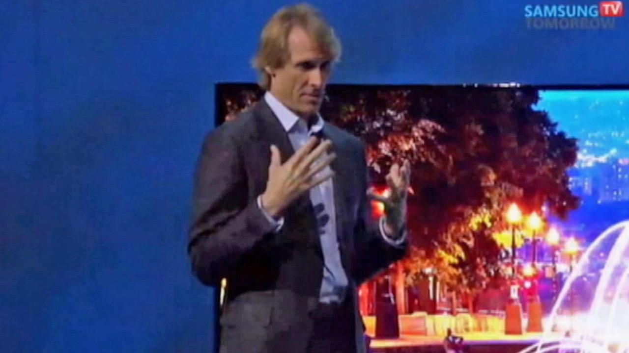 Director Michael Bay struggles on stage during a Samsung news conference at the International Consumer Electronics Show, Monday, Jan. 6, 2014, in Las Vegas.