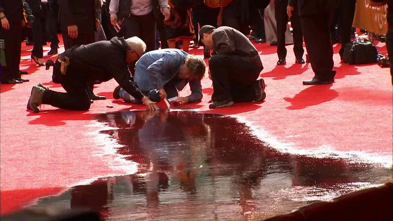 A fire sprinkler was set off outside the Beverly Hilton Sunday, drenching a section of the red carpet at the Golden Globes Sunday, Jan. 12, 2014.