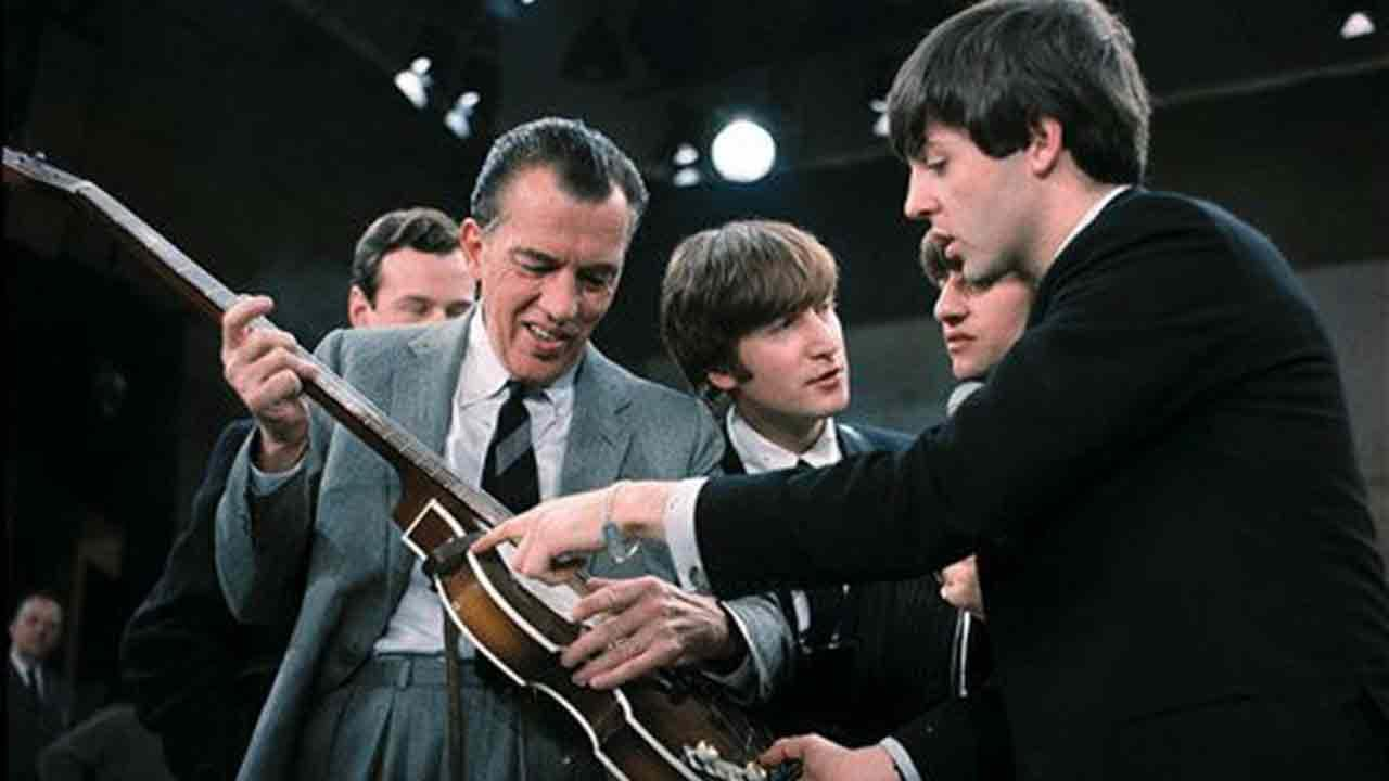 In this Feb. 9, 1964. file photo Paul McCartney, right, shows his bass guitar to Ed Sullivan before the Beatles live television appearance on The Ed Sullivan Show in New York.