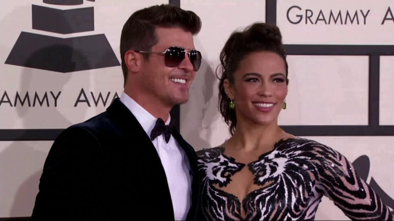 Robin Thicke and Paula Patton appear at the 2014 Grammy Awards in Los Angeles on Jan. 26, 2014.