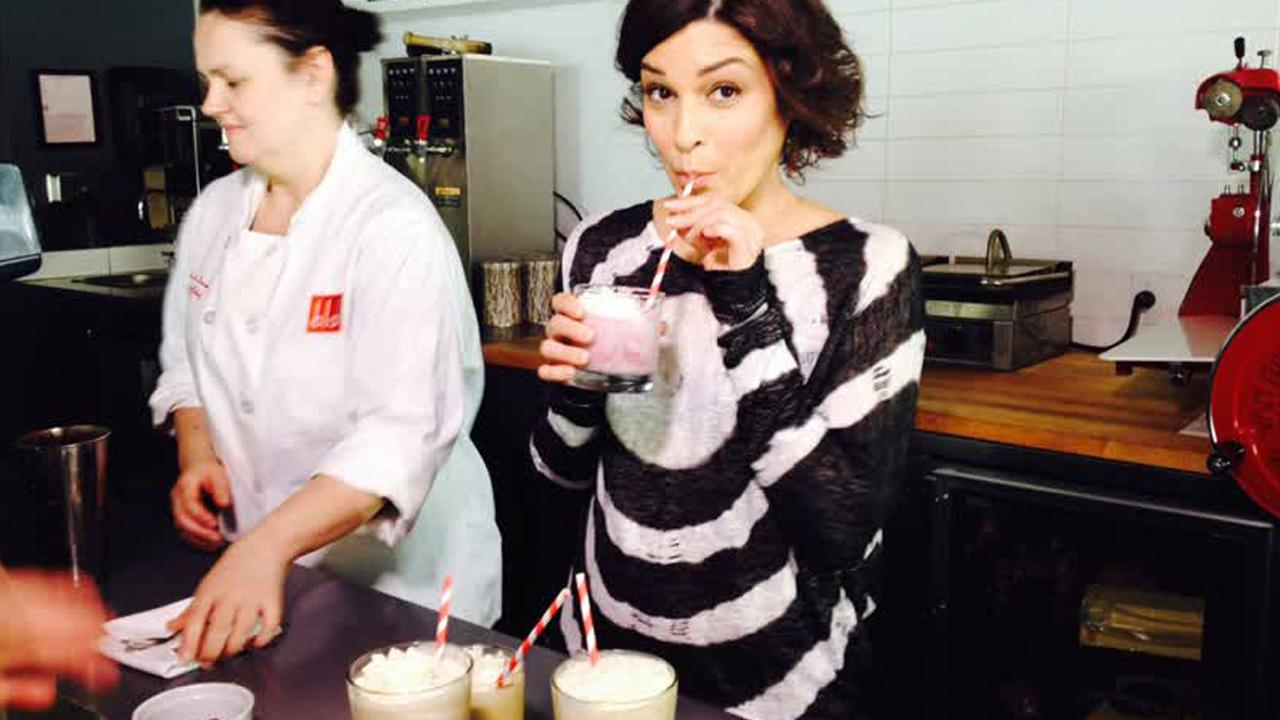 Eye on L.A. host Tina Malave drinks a milkshake while checking out the best comfort foods in Los Angeles, air date March 15, 2014.