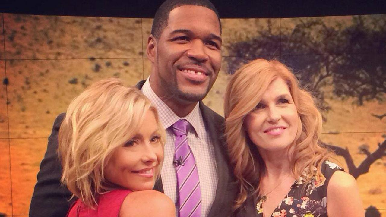 Kelly Ripa and Michael Strahan pose for a photo with actress Connie Britton on LIVE with Kelly and Michael on Wednesday, April 2, 2014.