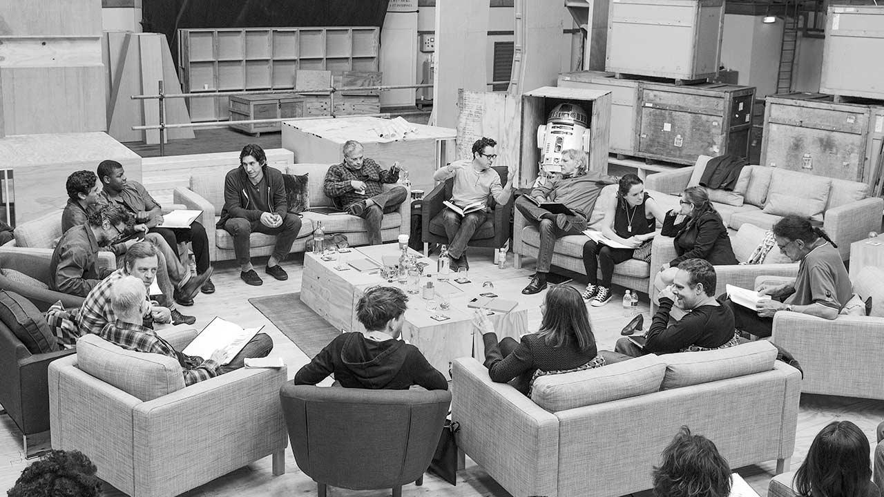 Writer/Director/Producer J.J. Abrams (top center right) at the cast read-through of Star Wars Episode VII at Pinewood Studios in the U.K. with (clockwise from right) Harrison Ford, Daisy Ridley, Carrie Fisher, Peter Mayhew, Producer Bryan Burk, Lucasfilm President and Producer Kathleen Kennedy, Domhnall Gleeson, Anthony Daniels, Mark Hamill, Andy Serkis, Oscar Isaac, John Boyega, Adam Driver and Writer Lawrence Kasdan. (Copyright and Photo Credit: David James.)