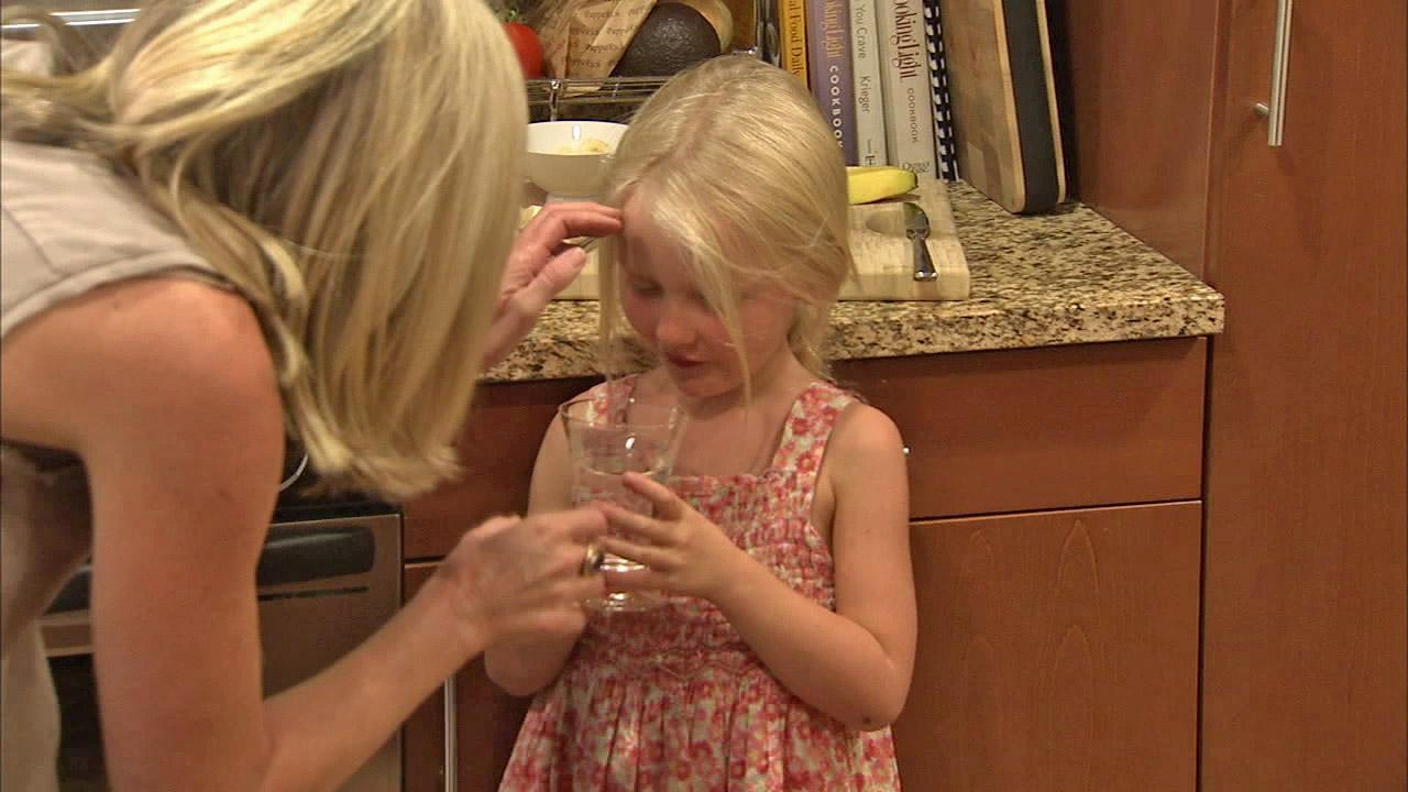 Katherine Wilemon gives her child, Ella, medication to lower her cholesterol, in this undated file photo.
