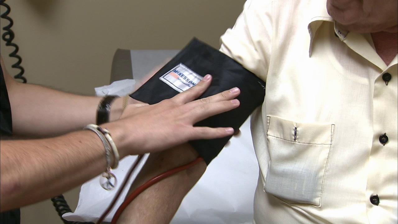 A patient gets his blood pressure measured  in this undated file photo.