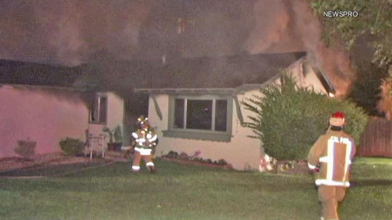 Firefighters battle a house fire in the 7000 block of Church Avenue in Highland on Thursday, July 12, 2012.