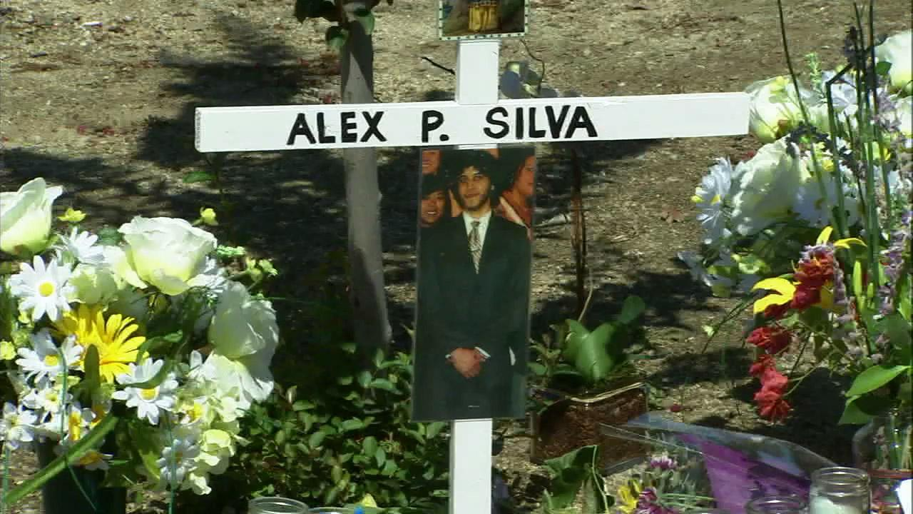 A cross with Alex Silvas picture stands at the site where the 25 year old was fatally struck by a car on Saturday, July 14, 2012.