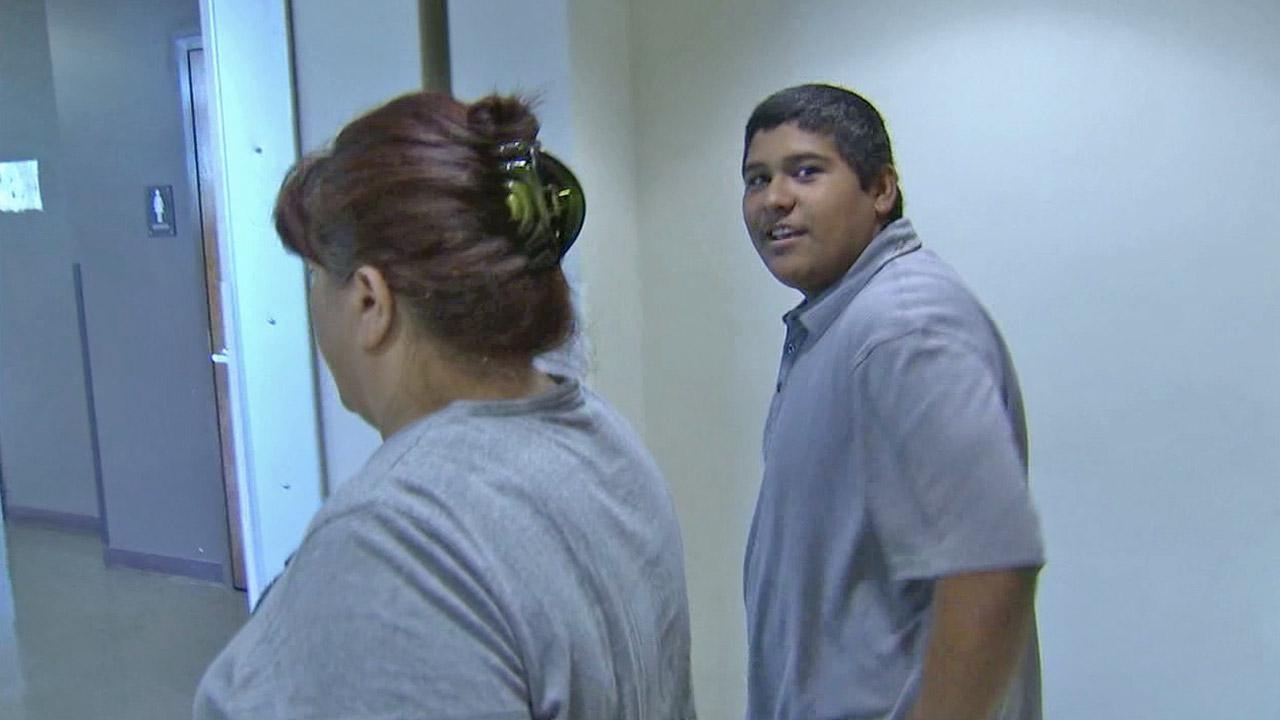 Fernando Salgado, 18, is seen leaving court in this Aug. 8, 2012 photo. Salgado is accused of sexually hazing his classmates at A.B. Miller High School in Fontana.