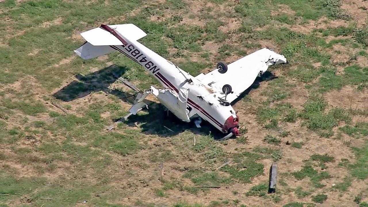 A plane is seen after it crashed in Chino on Friday, August 10, 2012. One person was injured in the crash.